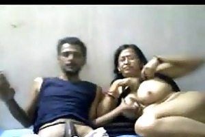 indian older pair mr and mrs gupta in cam