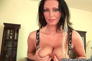 soccer mama with enormous boobs is dildoing her