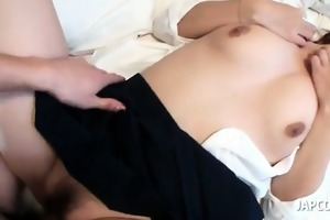 oriental doll in school uniform receives shaggy