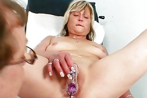 excited blond granny toys her fur pie at gyno