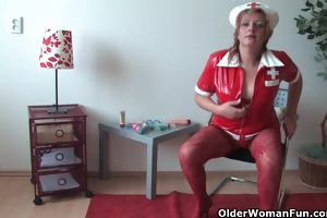 aged mamma in perverted outfit rubs her love