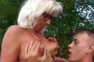 grandma copulates younger lad outdoors