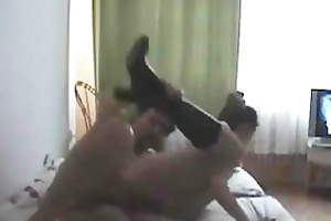brunette with boots has missionary and doggy style
