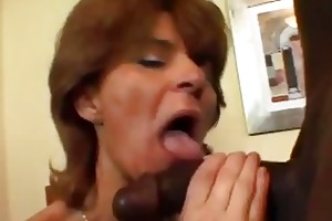 older bitch in fishnets takes dark cock
