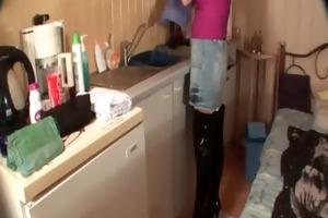 older floozy in boots masturbates in kitchen