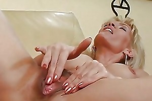 older blond plays with herself