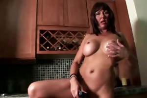 aged bitch teasing with toy