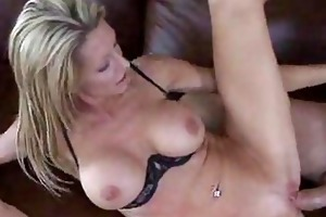 mature blond sits down on soft bed and copulates