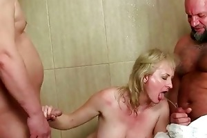 grandma and lads in pissing threesome act