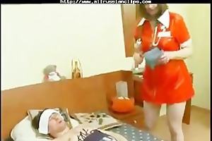 older nurse tends to youthful patient. russian