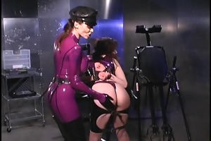 latex mistress punishes captured dark brown