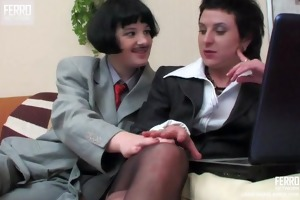 lesbo crossdressers giving a kiss and strapon