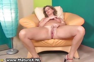 excited aged lady widens her legs part1
