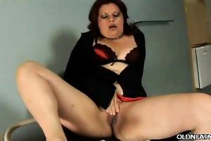 aged latina rubbing her muff