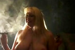 older blonde smokin cigars and riding sybian
