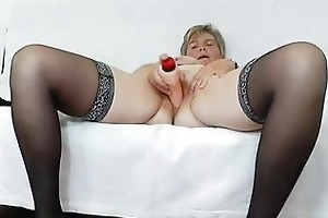 orgastic wife playing with a rubber shlong